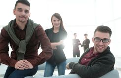Young professionals in the workplace. Group of young professionals in the workplace stock image