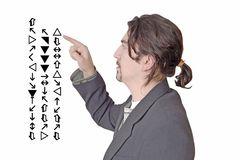 Young professor explains l. Young professor explains symbols in white wall Stock Photos