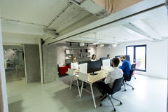 Young programmers sit and work in modern office. Young programmers sit and work in a modern office Stock Images