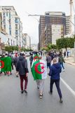 Young protesters in Algiers`s streets stock images