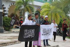 Young Proud With Al-Islam Flag Al Liwa Ar Roya Stock Images