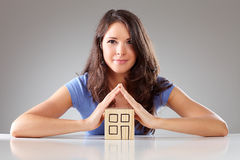 Young proudly woman make a roof with hands, symbolical Royalty Free Stock Photo