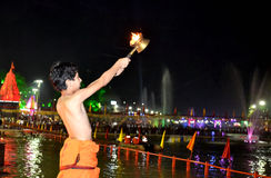 A young pundit boy performing river aarti on the bank of kshipra at the simhasth maha kumbh mela 2016, Ujjain India Stock Photography