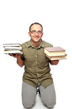 Young punished, kneeling with books in hands Stock Photo