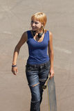 Young punk girl skater with headphones Royalty Free Stock Photos