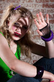 Young Punk Rocker. Shielding her face from the light Royalty Free Stock Photos