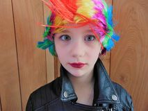 Young Punk Rocker Chick With Rainbow Mohawk. Young punk rocker chick poses for the camera Royalty Free Stock Images