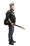 Young punk rocker holding an electric guitar Stock Image