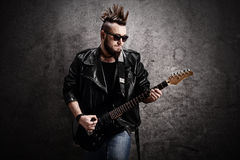 Young punk rocker playing electric guitar Royalty Free Stock Image