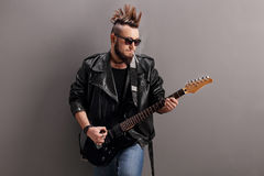 Young punk rocker playing electric guitar Stock Image