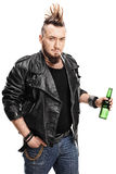 Young punk smoking cigarette and holding beer Royalty Free Stock Image