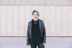 Young punk woman with blue dyed hair and a leather jacket stock photos