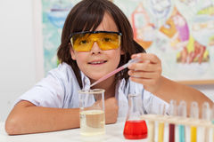 Young pupil conducting a simple chemical experiment Royalty Free Stock Photography