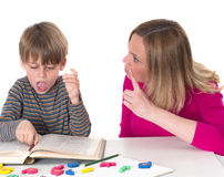 Young pupil doesn't want to learn, he confronts his mother who is threatening him Royalty Free Stock Photos