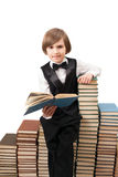 A young pupil is reading book Royalty Free Stock Photo