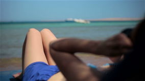Young pure girl woman lying on beach of sea, wears stock video footage