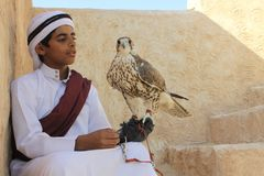 Young Qatari boy in traditional dress stock image