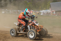 Young quad rider in the dynamic motion Royalty Free Stock Photo