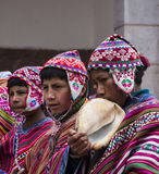 Young Quechua Indians at mass in village of Pisac, Peru Stock Photography