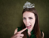 Young Queen Makes a Gagging Gesture Stock Photo