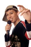 Young rapper. Photo of smiling boy singing a rap song Royalty Free Stock Photography