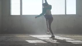 Skillful young man dancing in an abandoned building. Hip hop culture. Rehearsal. Contemporary. Dance with a flip. Young rapper dancing in an abandoned building stock video