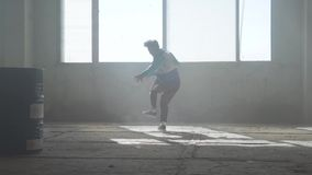 Skillful young man dancing in an abandoned building. Hip hop culture. Rehearsal. Contemporary. stock footage