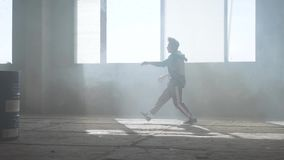 Young rapper dancing in an abandoned building. Hip hop culture. Rehearsal. Contemporary. stock footage