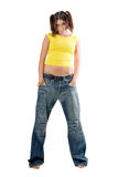Young rapper girl. Rapper girl in wide jeans. Isolated on white Royalty Free Stock Images
