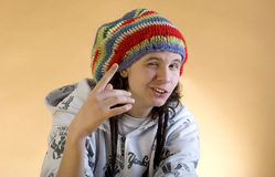 Young rapper showing thumbs. Stock Photos