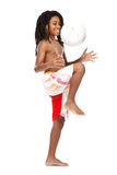 Young rasta guy with football in studio Stock Images