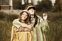 Young fashion rastafarian couple walking in autumn park Royalty Free Stock Photo