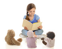 Young Reader, Tiny Listeners Royalty Free Stock Photos