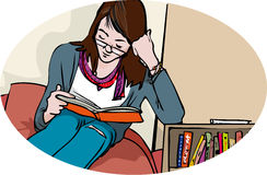 Young reader. Young woman sitting and reading a book Stock Photography