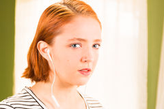 Young Readhead Girl With Headphones Royalty Free Stock Photos