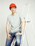 Young real hard worker man isolated on white background on ladder smiling posing, business concept Stock Photography