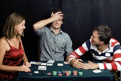 Young real people playing poker Royalty Free Stock Photos