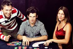 Young real people playing poker, lifestyle people concept Royalty Free Stock Images