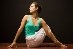 Young real yoga instructor practicing Stock Image