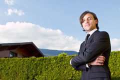 Young realtor with blue skies Stock Photography