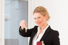 Young realtor is with keys in an apartment stock image
