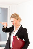 Young realtor is with keys in an apartment Royalty Free Stock Photo