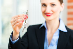 Young realtor is with keys in an apartment Stock Photography