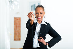 Young realtor with keys in an apartment. It could be the tenant too Royalty Free Stock Image
