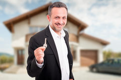 Young realtor offering house keys Stock Photography