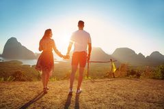 Young couple watching an asian sunset royalty free stock image