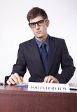 Young receptionist. Showing direction to job interview Stock Image