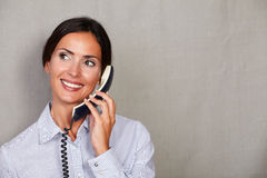 Young receptionist talking on the phone Stock Images