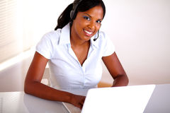 Young receptionist working on customer service Stock Photography