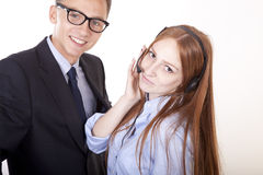 Young receptionists. Working and smiling Royalty Free Stock Photo